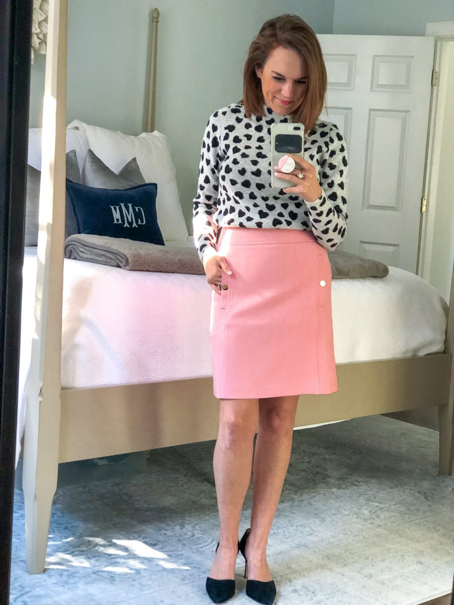heart mock neck sweater paired with pink skirt