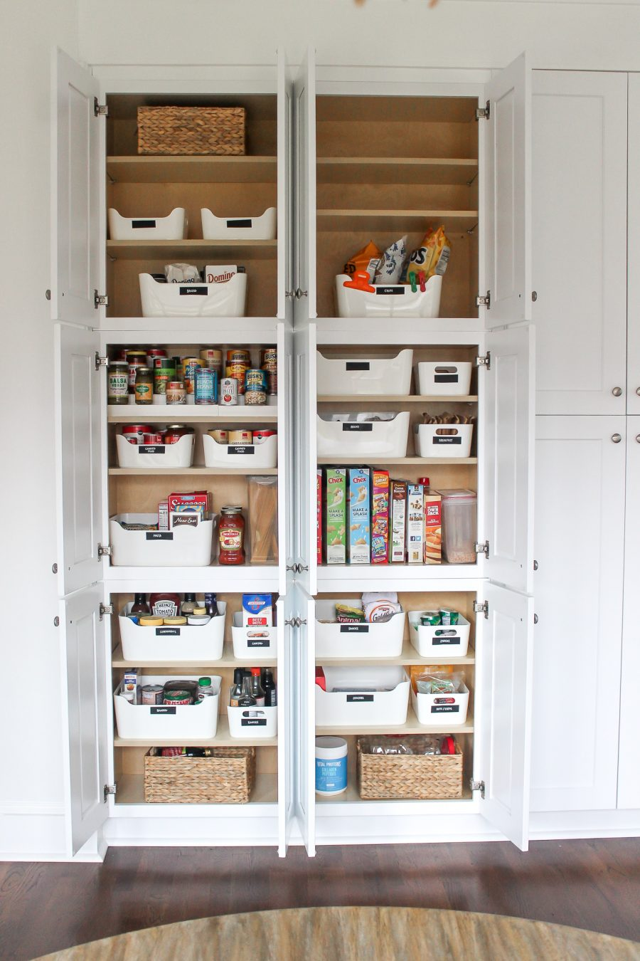North Carolina lifestyle blogger, Christina shares a look inside her kitchen reno! Check out the kitchen cabinetry & kitchen organization tips!
