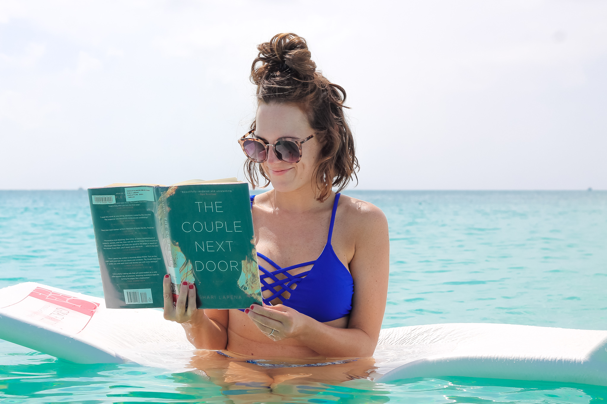 reading on beach Turks & Caicos